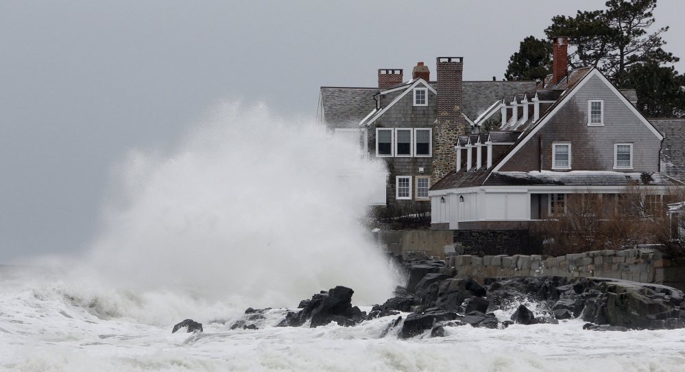 Storm-driven waves slam into the rocks in front of a house along the shore in Kennebunk on March 8, 2013.