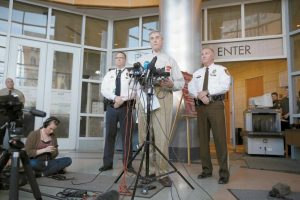 ST. LOUIS COUNTY PROSECUTOR ROBERT MCCULLOCH, center, speaks during a news conference along side St. Louis County Police Chief Jon Belmar, right, and Webster Groves Police Captain Stephen Spear, left, Sunday, March 15, in Clayton, Missouri. McCulloch announced Jeffrey Williams is charged with two counts of first-degree assault in the shootings of two St. Louis area officers.