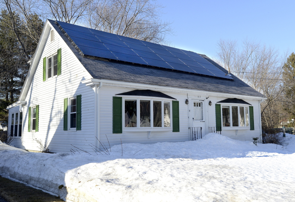 The roof of this home at 103 Wolcott St. in Portland has been fitted with solar panels. At least four bills to be considered by the Legislature would create incentives for solar energy.