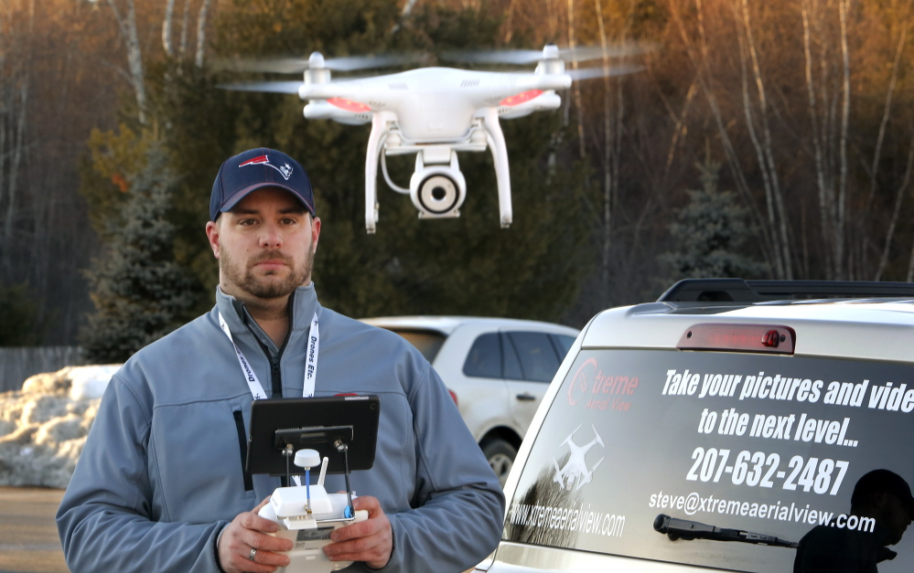 """Steve Girard takes aerial photos and videos using his drone. The Gorham man received a voice mail from a local FAA administrator ordering him to """"pull down"""" his website about his service, and threatening """"fines and penalties for this activity."""""""