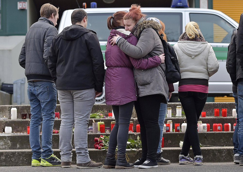 Two girls hug in front of the Joseph-Koenig-Gymnasium in Haltern, western Germany on Tuesday. Among those on the plane were 16 students and two teachers from Haltern.