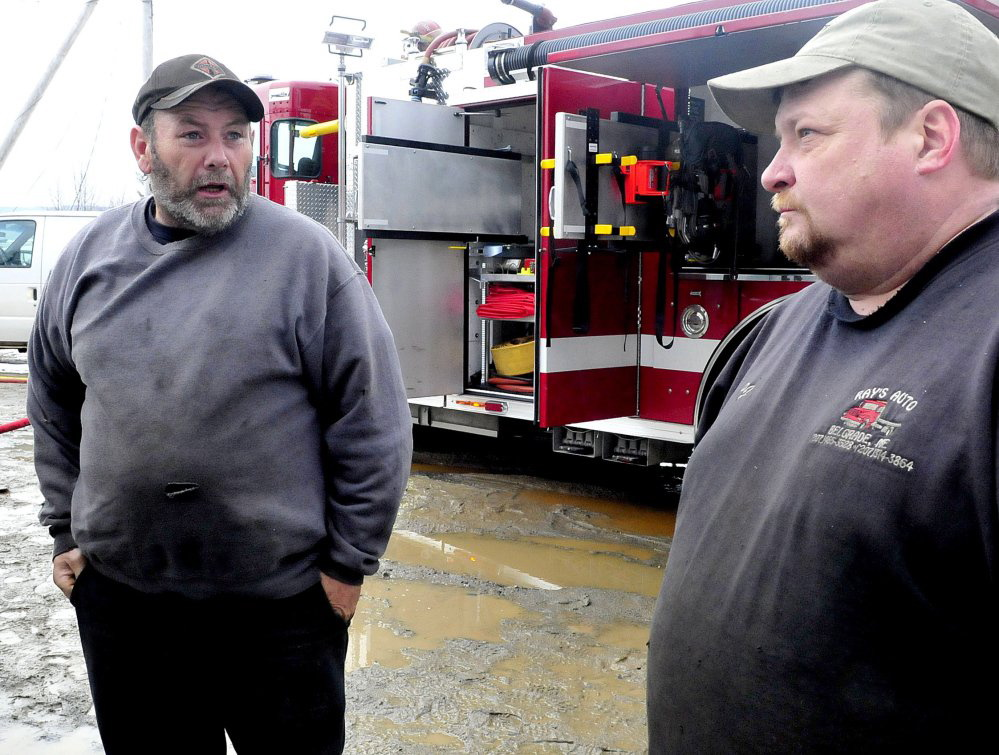 Owners Ray Frappier, left, and Percy French aren't sure whether they will rebuild Ray's Auto, which was destroyed by fire Monday.