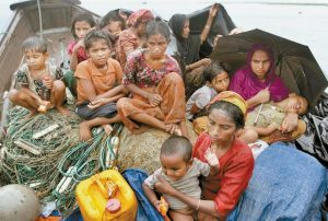 ROHINGYA MUSLIMS who fled Myanmar to Bangladesh to escape religious violence, sit in a boat after being intercepted crossing the Naf River by Bangladeshi authorities in Taknaf, Bangladesh, in this June 13, 2012 photo. Asia's more than 1 million ethnic Rohingya Muslims are considered by rights groups to be among the most persecuted people on earth. Two recent shipwrecks in the Mediterranean Sea believed to have taken the lives of as many as 1,300 asylum seekers and migrants has highlighted the escalating flow of people fleeing persecution, war and economic difficulties in their homelands.