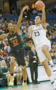 CONNECTICUT FORWARD Kaleena Mosqueda-Lewis (23) shoots as Maryland guard Shatori Walker-Kimbrough (32) defends during the second half of the NCAA Women's Final Four tournament college basketball semifinal game on Sunday in Tampa, Fla. UConn will face Notre Dame in the title game on Tuesday at 8:30 p.m.