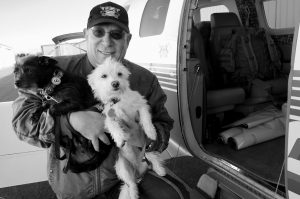 YAHUDA NETANEL carries two rescue dogs prior to a flight out of the Van Nuys Airport, in Van Nuys, Calif. on Wednesday, April 8. Netanel, founder and president of Wings of Rescue, says business has doubled each of the past 4 1/2 years. He started as the lone pilot who rescued 300 dogs, and now the group expects to fly 7,000 pets in 2015.