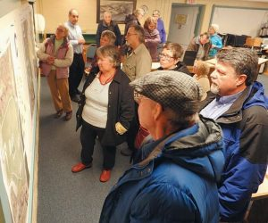 COMMUNITY MEMBERS examine and discuss the improvement maps for South End Park at Thursday's open house in Bath.