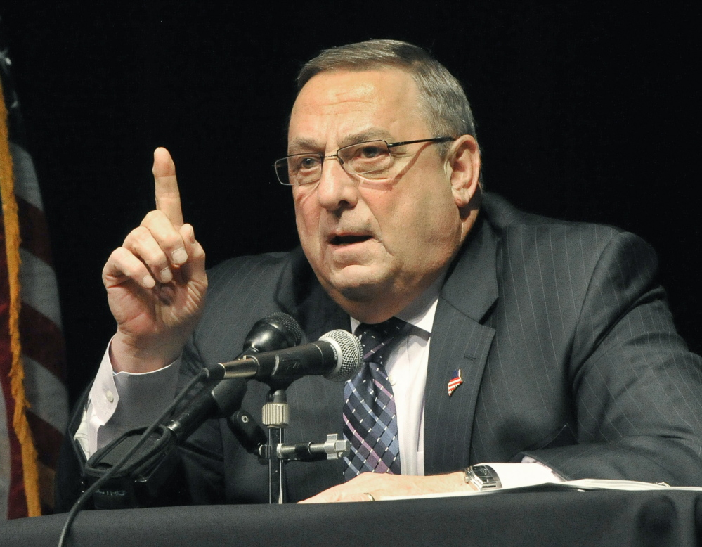 Gov. Paul LePage discusses his tax reform plan at a town hall forum in Saco on Thursday night. The session came to a halt after a vocal disturbance by Joanne Twomey.
