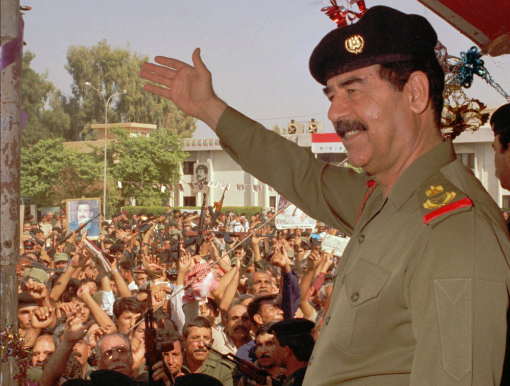 Saddam Hussein waves to supporters in Baghdad in 1995.
