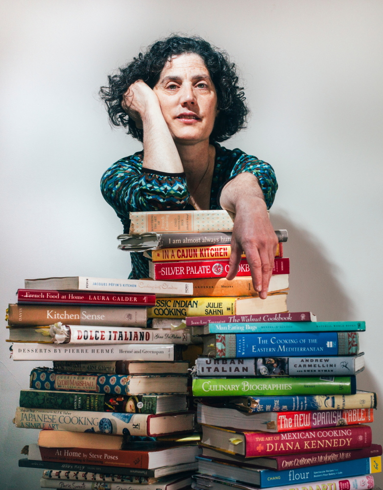 Peggy Grodinsky, with a fraction of her cookbook collection.