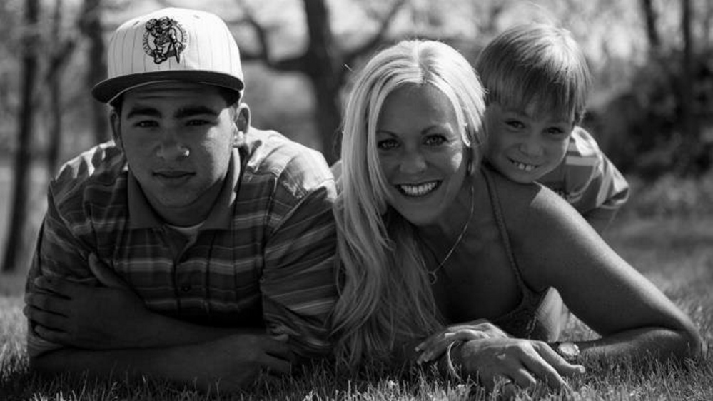 Treyjon Arsenault, left, his mother, Nancy Laxson, and his brother Ashton Laxson in 2012.