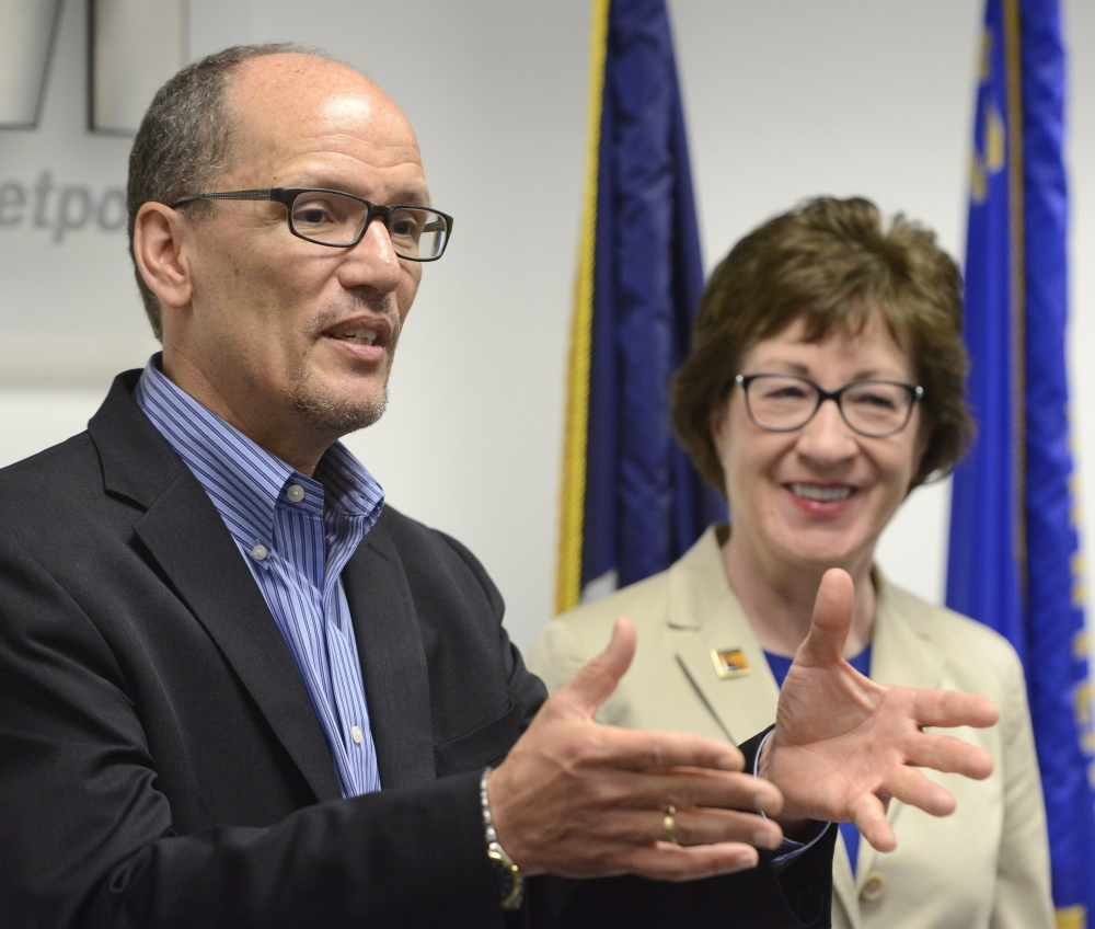 Secretary of Labor Thomas Perez and Sen. Susan Collins hold a press conference in Portland in May of 2015.