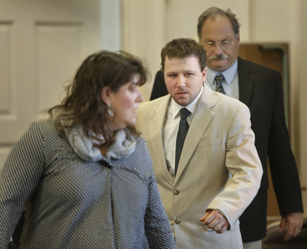Derek Poulin follows his attorney, Amy Fairfield, into York County Superior Court in Alfred for the opening of his murder trial on Thursday. Poulin is accused of killing his grandmother, Patricia Noel, and setting her Old Orchard Beach home on fire in 2012.