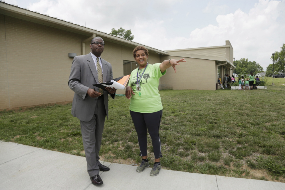 Jill Wilson, right, director of the community center, gave a tour to Emmanuel Caulk at William Wells Brown Elementary School in Lexington, Ky., on June 23. Caulk was hired Saturday night to lead the 40,000-student Lexington public school system.