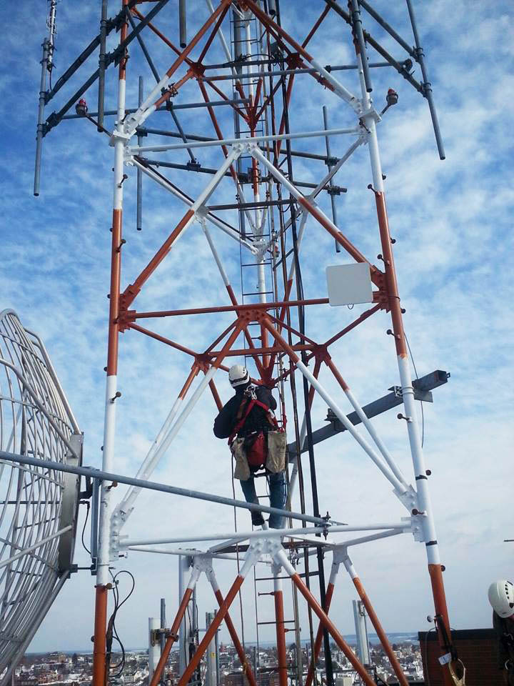 Scott Smith, tower installation foreman at Tilson, climbs a tower used by Redzone Wireless in Portland. Redzone Wireless hopes to provide speedy broadband service to most of Maine by 2017, the company announced Wednesday.