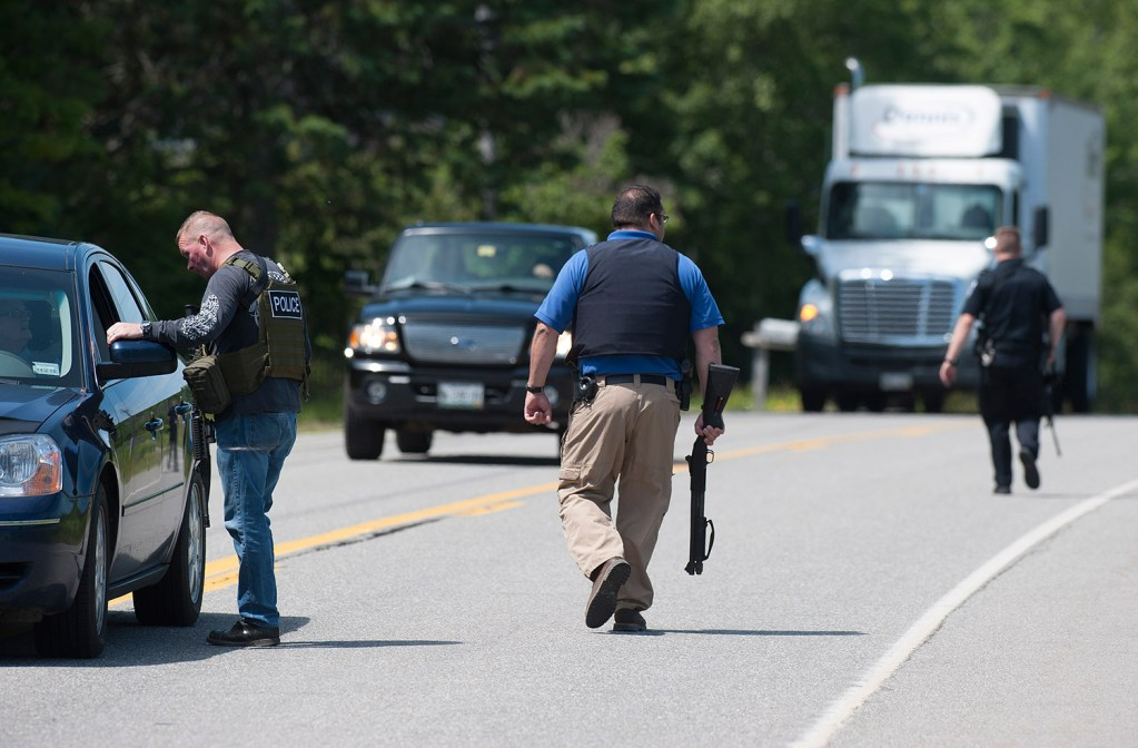 Police in Lincoln fan out to turn away traffic headed into Lee on Route 6 Friday during a manhunt for a gunmen who shot multiple people.