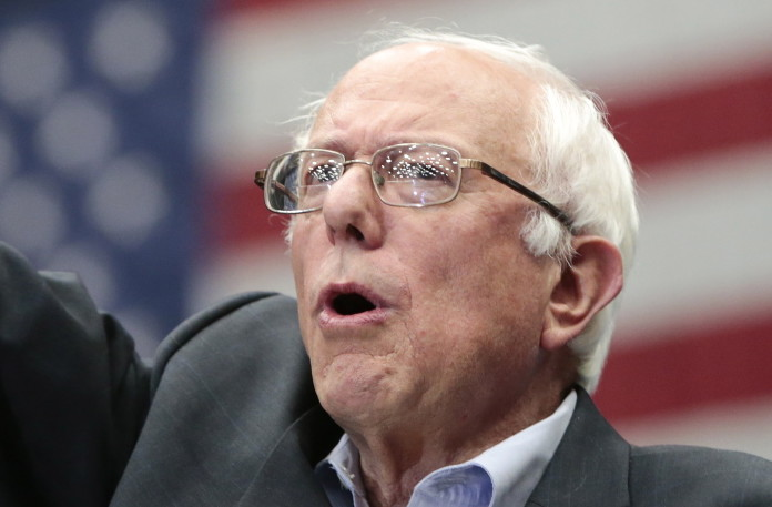 Democratic presidential candidate Sen. Bernie Sanders, I-Vt., arrives at a  rally Wednesday in Madison, Wis. The Associated Press