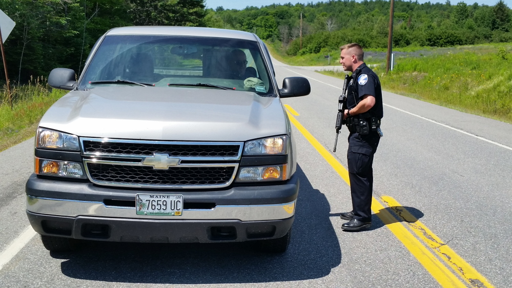 Lincoln Officer Josh McKechnie stops a truck headed into Lee at the Lincoln-Lee town line.