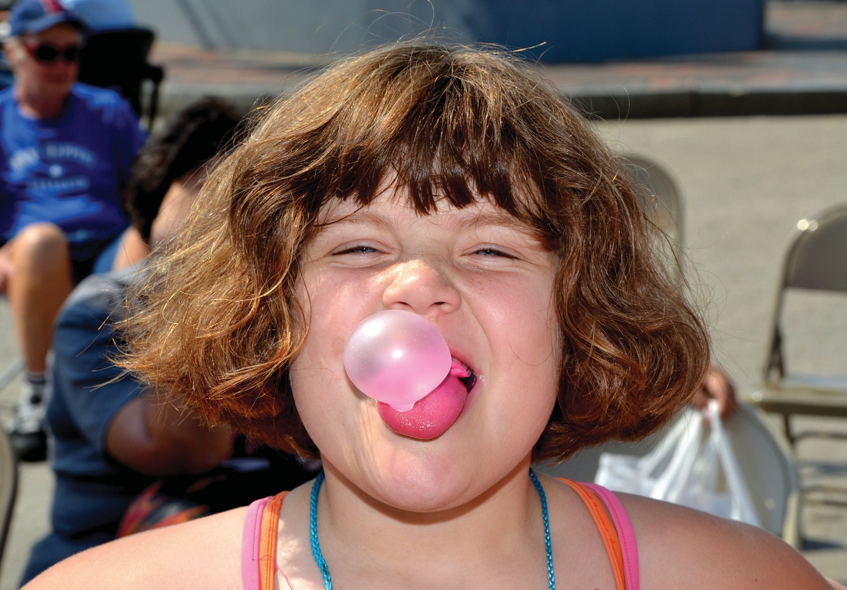 A participant in a previous year's Beach Olympics in Old Orchard Beach competes in the bubble gum blowing contest.