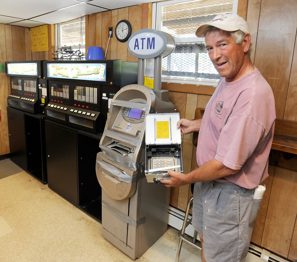 Don Cobb of American Legion Post 86 in Gray shows the money box and keypad that were destroyed by thieves who also broke into the office safe on Saturday.