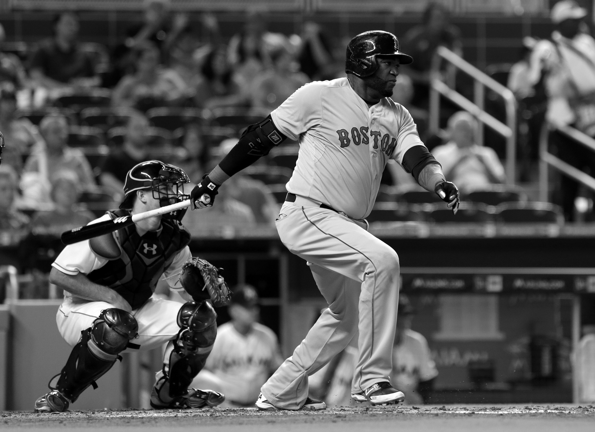 Boston Red Sox designated hitter David Ortiz follows through on a base hit against the Miami Marlins during the fourth inning of a baseball game, Wednesday in Miami. Xander Bogaerts reached third base on the single. Ortiz hit two home runs in the game, but the Red Sox were blasted by the Marlins, 14-6.