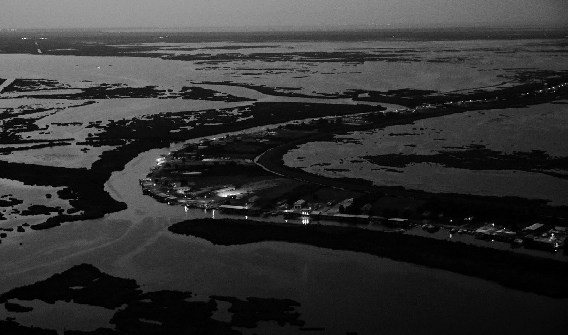 This aerial photo shows Delacroix Island surrounded by fragmenting and eroding marshland and coastal waters in St. Bernard Parish, La. on Tuesday.