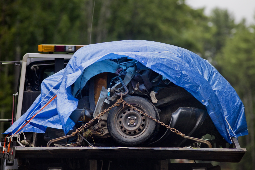 The mangled remains of the front of the 1993 Honda Civic that Michael Minson was driving on Aug. 11 are towed away from the scene. Gabe Souza/Staff Photographer