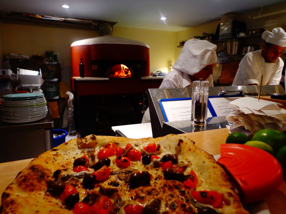 The wood-fired pizza is the draw at Meanwhile, the casual restaurant opened in March in Belfast by Alessandro Scelsi and Clementina Senatore.