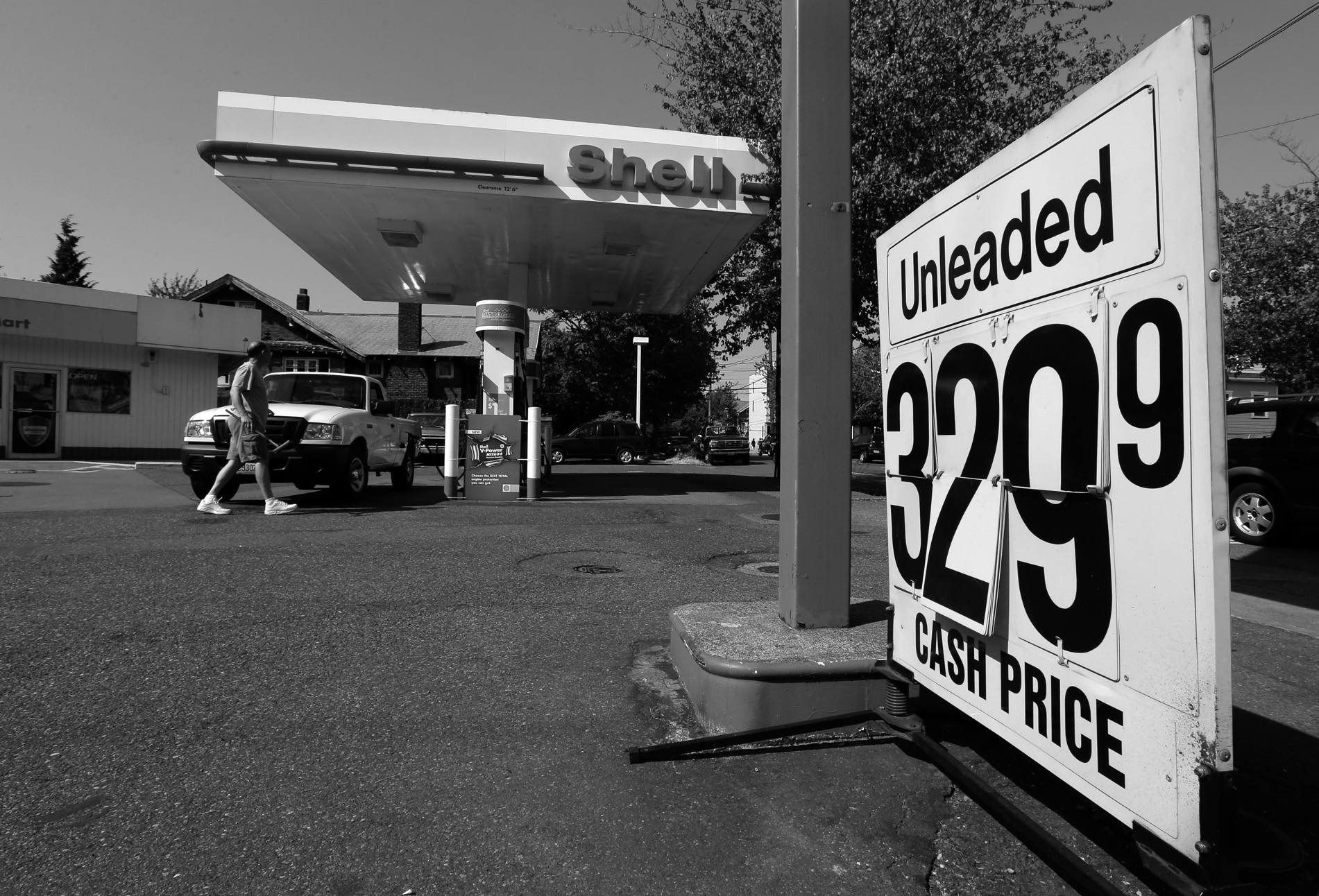 In this Aug. 13 photo, the cash price for gasoline is shown on a changeable sign at a gas station in Seattle. Washington state recently approved a 16-year, $16 billion transportation plan that raises fuel taxes, vehicle fees and bonding.