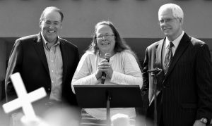 ROWAN COUNTY CLERK KIM DAVIS, center with Republican presidential candidate Mike Huckabee, left, and attorney Mat Staver, right, founder of the Liberty Counsel, the Christian law firm representing Davis, at her side, greets the crowd after being released from the Carter County Detention Center, Tuesday, Sept. 8, in Grayson, Kentucky. Davis, the Kentucky county clerk who was jailed for refusing to issue marriage licenses to gay couples, was released after five days behind bars.
