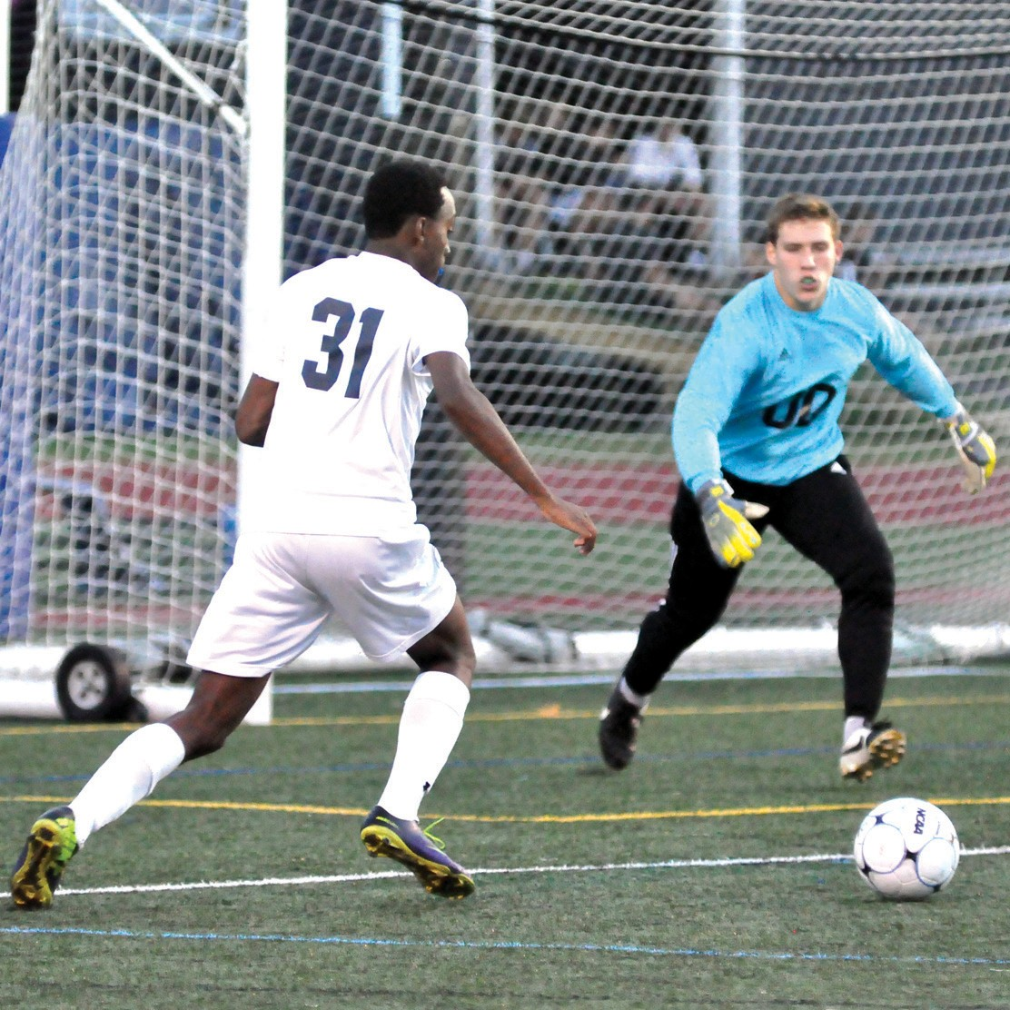 Yarmouth's Tahj Garvey (31) looks to take a shot against Kennebunk goalie Sean Berry during an 8- 0 Clippers' victory in Yarmouth Monday.