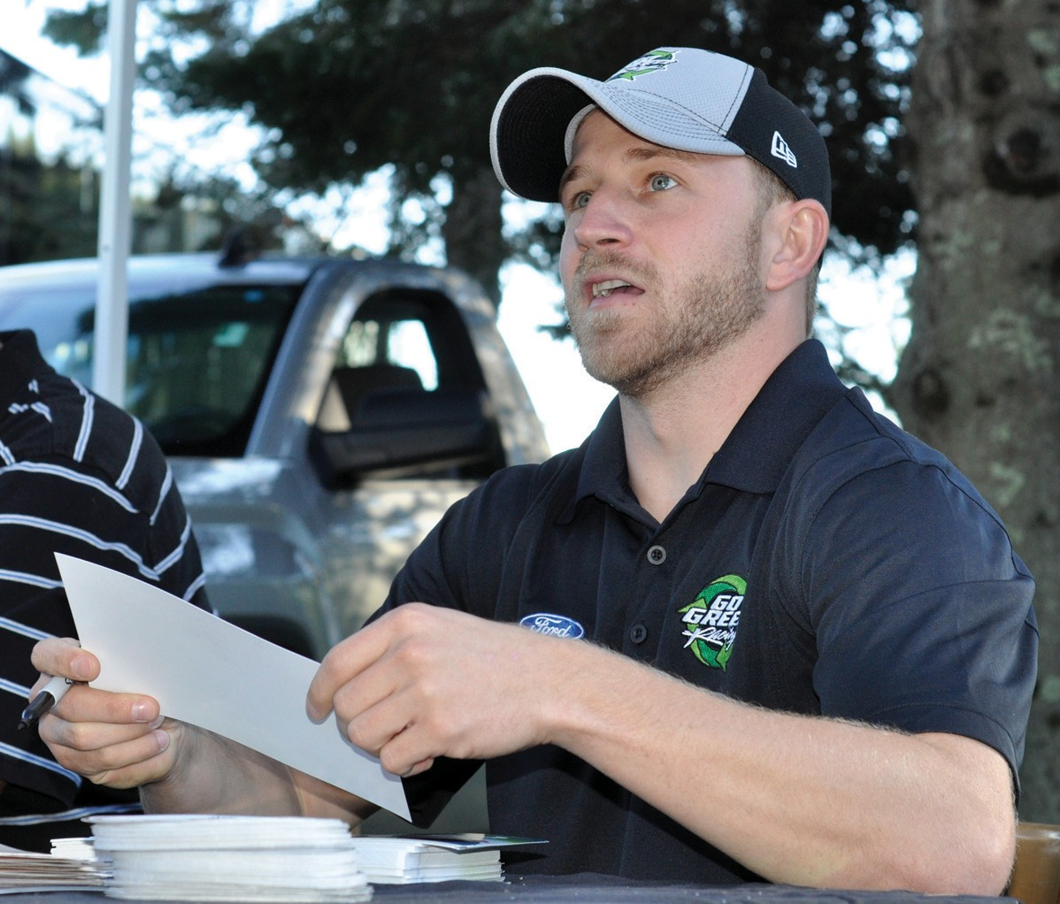 NASCAR driver Jeffrey Earnhardt signs autographs during a meet-and-greet session at Bentley's Saloon in Arundel Wednesday.