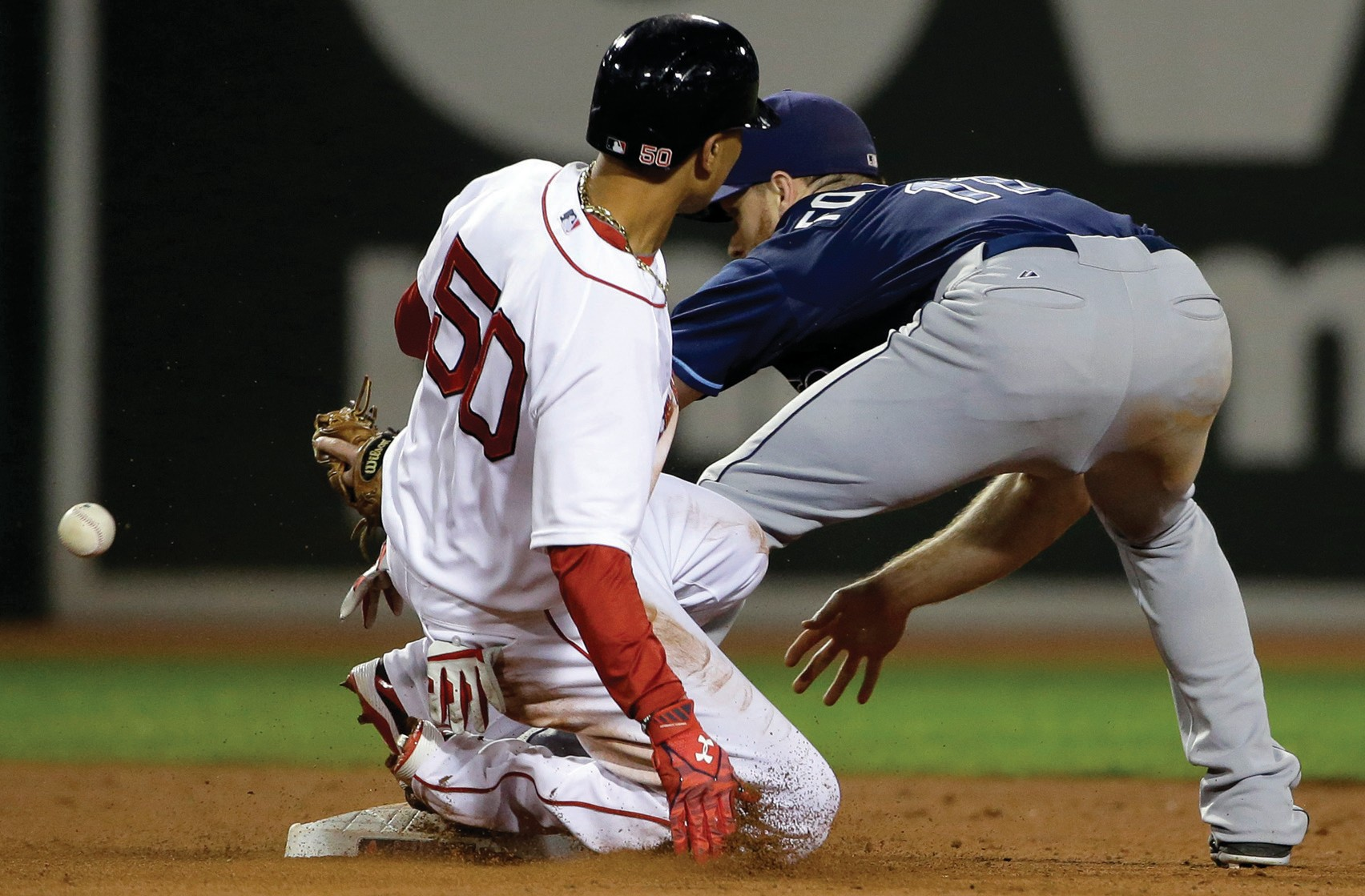 Boston Red Sox's Mookie Betts, left, slides safe at second base as Tampa Bay Rays' Logan Forsythe, right, is unable to handle the ball in the seventh inning on Monday at Fenway Park in Boston.