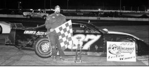 CHUCK COLBY of Wiscasset poses for a photo after winning a 45-lap Late Model Sportsmen feature at Wiscasset Speedway on Saturday.