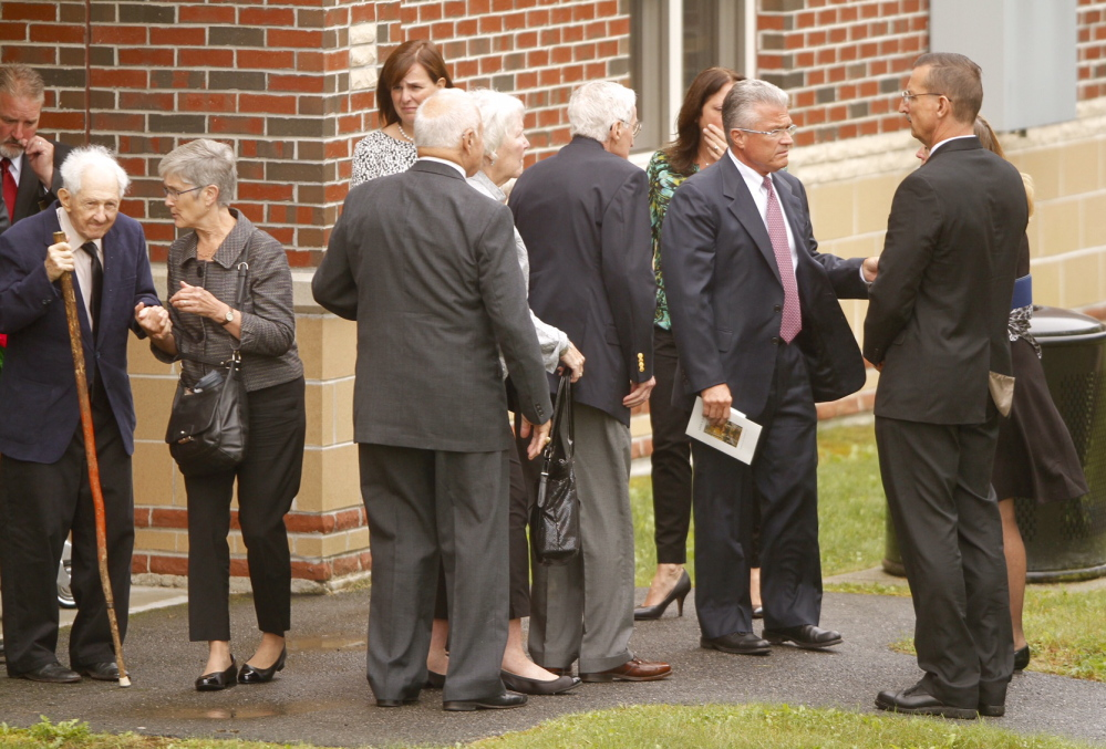 Current L.L. Bean CEO Christopher McCormick, second from right, and others gather after Leon Gorman's memorial service at the Westbrook Performing Arts Center on Sunday.