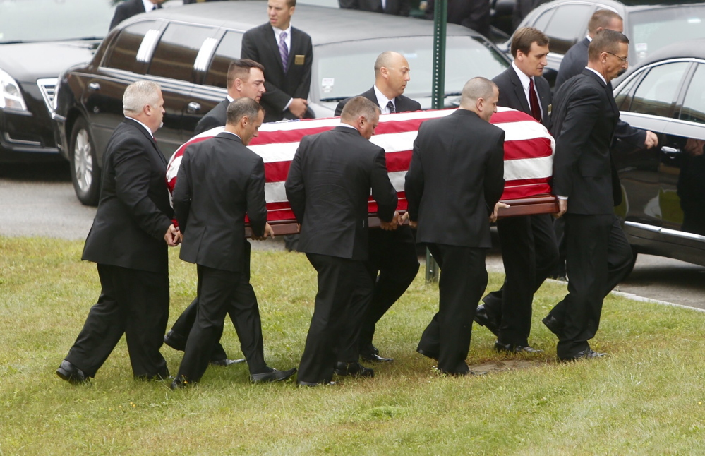 Pallbearers carry the casket of Leon Gorman from his memorial service at the Westbrook Performing Arts Center on Sunday.