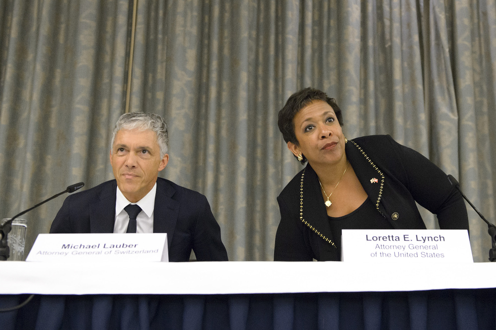 Michael Lauber, attorney general of Switzerland, and Loretta Lynch, U.S. attorney general, attend a news conference in Zurich on Monday.