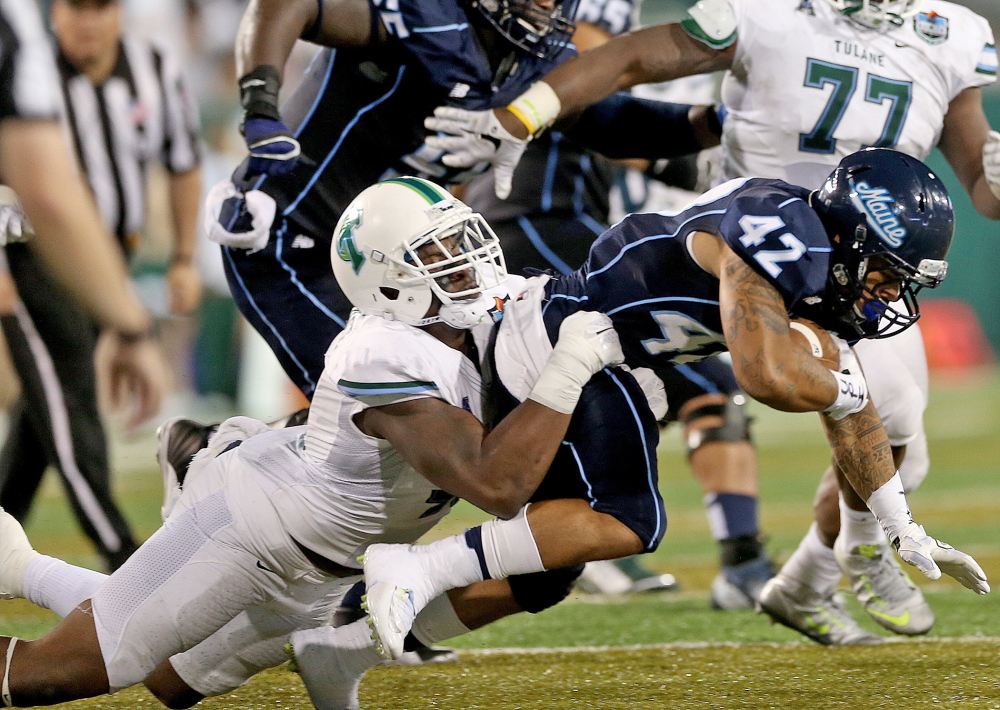 Tulane defensive end Royce LaFrance (48) drops Maine running back Darian Davis-Ray (42) for a loss during the second quarter Saturday in New Orleans.