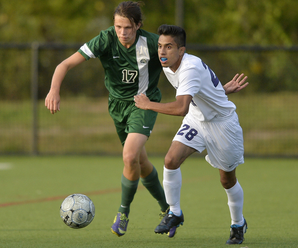 Bonny Eagle's Aaron Rae, left, and Deering's Muzamell Osmani Azizi race for the ball during the Rams' 5-3 boys' soccer win Monday.