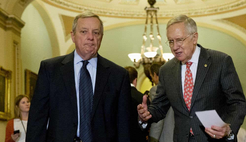 Senate Minority Leader Harry Reid, right, and Senate Minority Whip Richard Durbin arrive for a news conference on Capitol Hill on Tuesday. Earlier in the day, Democrats voted down a GOP bill to ban late-term abortions.