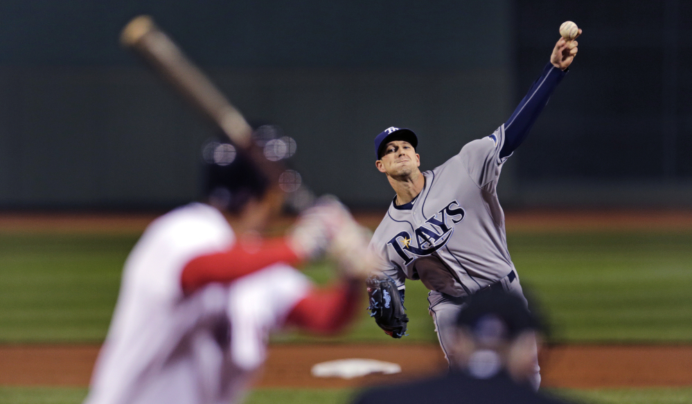 Tampa Bay Rays starting pitcher Drew Smyly delivers in the first inning on his way to a win over the Red Sox. Smyly held the Red Sox to five hits and no runs, pitching into the seventh inning.