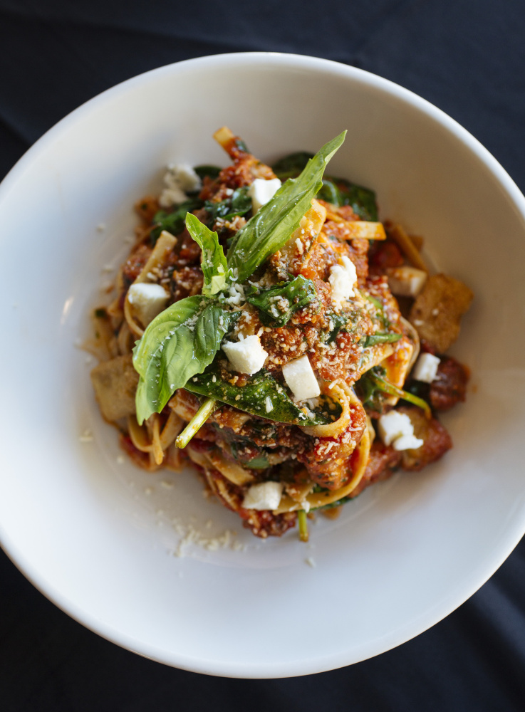 Fettuccine with sausage and crispy eggplant.