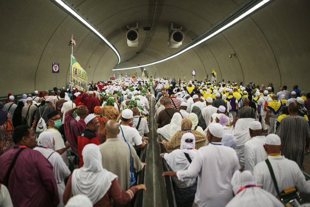 Muslim pilgrims walk in a tunnel on their way to cast stones at Jamarrat pillars, a ritual that symbolizes the stoning of Satan, during the annual pilgrimage, known as the hajj, in Mina, near the holy city of Mecca, Saudi Arabia on Friday.