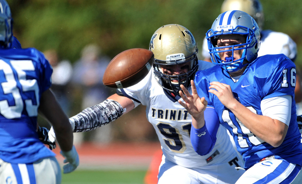 Colby's Christian Sparacio, right, pitches the ball to teammate Robert Murray during the Mules' 34-0 loss to Trinity in the NESCAC football opener for both teams Saturday in Waterville.