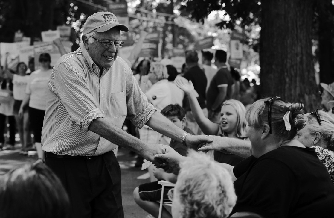 Democratic presidential candidate Sen. Bernie Sanders, I-Vt., reaches out to shake hands with voters as he walks in the Labor Day parade in Milford, N.H. on Sept. 7.