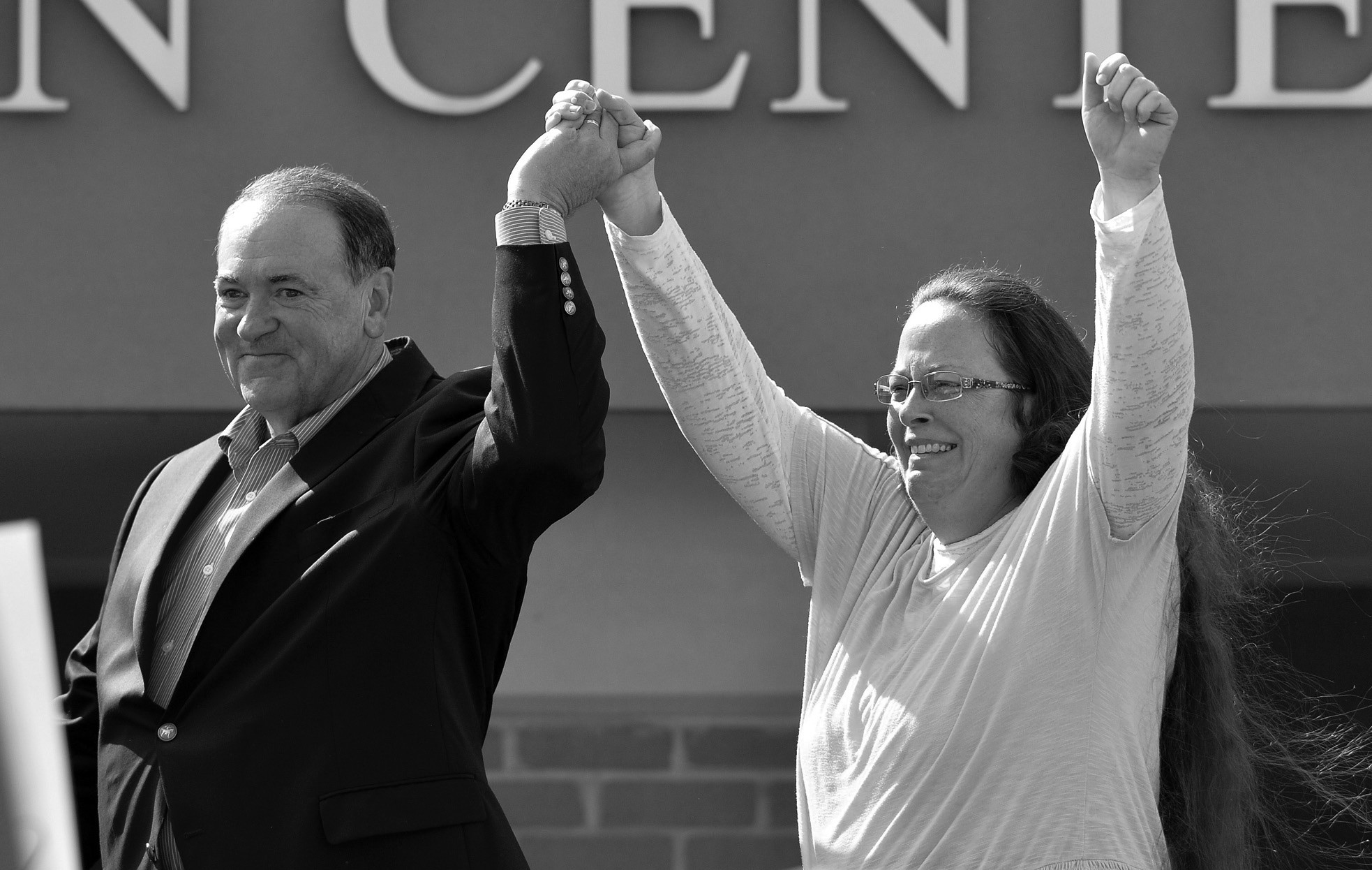 In this Sept. 8, file photo, Rowan County Clerk Kim Davis, with Republican presidential candidate Mike Huckabee at her side, greets the crowd after being released from the Carter County Detention Center, in Grayson, Ky.