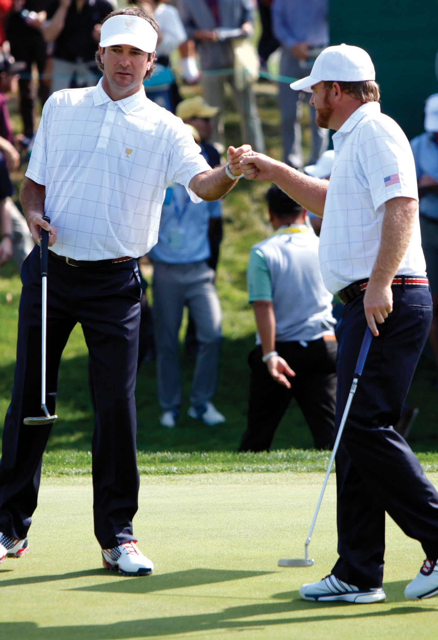 United States' Bubba Watson, left, and teammate J.B. Holmes celebrate during their foursome match at the Presidents Cup golf tournament at the Jack Nicklaus Golf Club Korea, in Incheon, South Korea, Thursday.