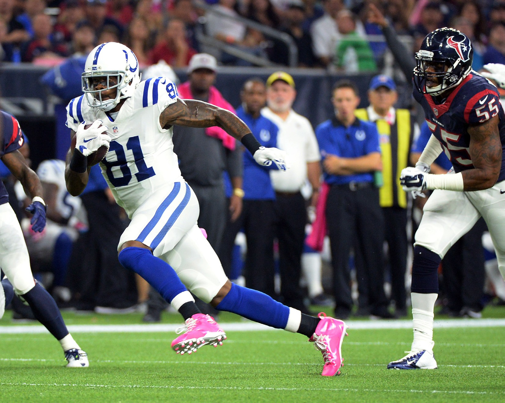 Indianapolis Colts' Andre Johnson is chased by Houston Texans' Benardrick McKinney (55) after a reception during the first half of an NFL football game Thursday in Houston.