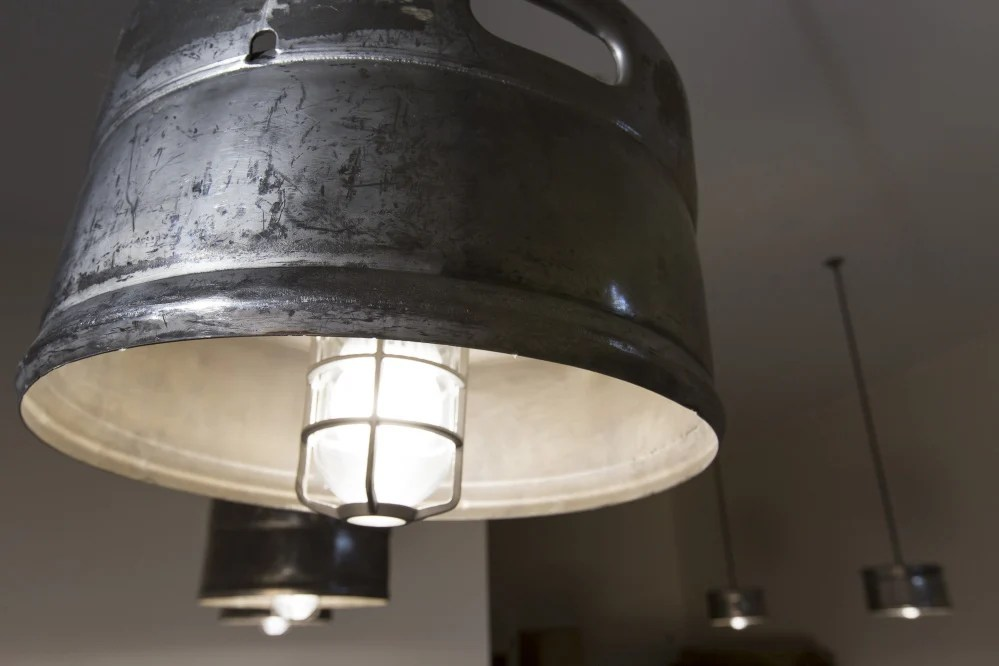 The ceiling fixtures at the Fore River Brewing Co. are made from repurosed beer kegs. Ben McCanna/Staff Photographer