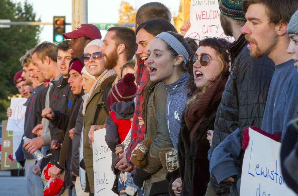 The crowd that gathered Monday to protest campaign signs aimed at mayoral candidate Ben Chin said it was important to show Lewiston is a welcoming city that won't tolerate hate.