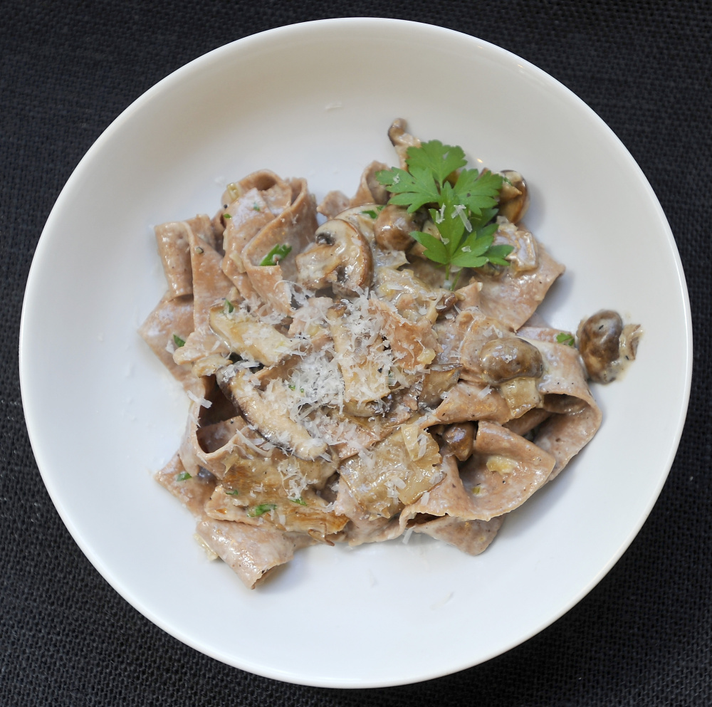 Acorn Taglietelle with Mushroom Cream Sauce garnished with grated Parmesan cheese and fresh parsley. Gordon Chibroski/Staff Photographer